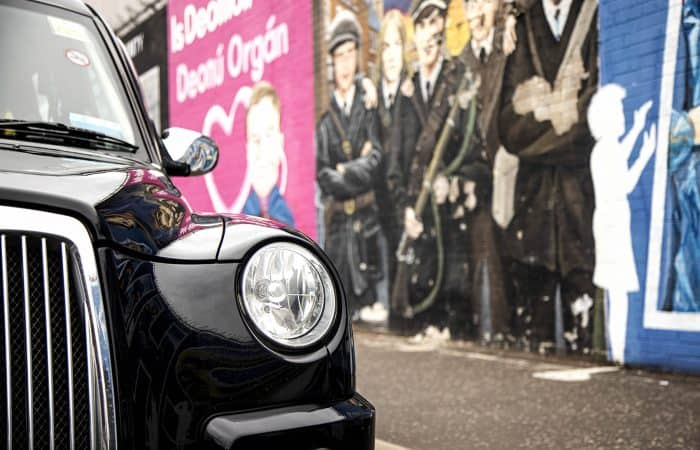 Belfast Mural Tours Black Taxi at The International Wall