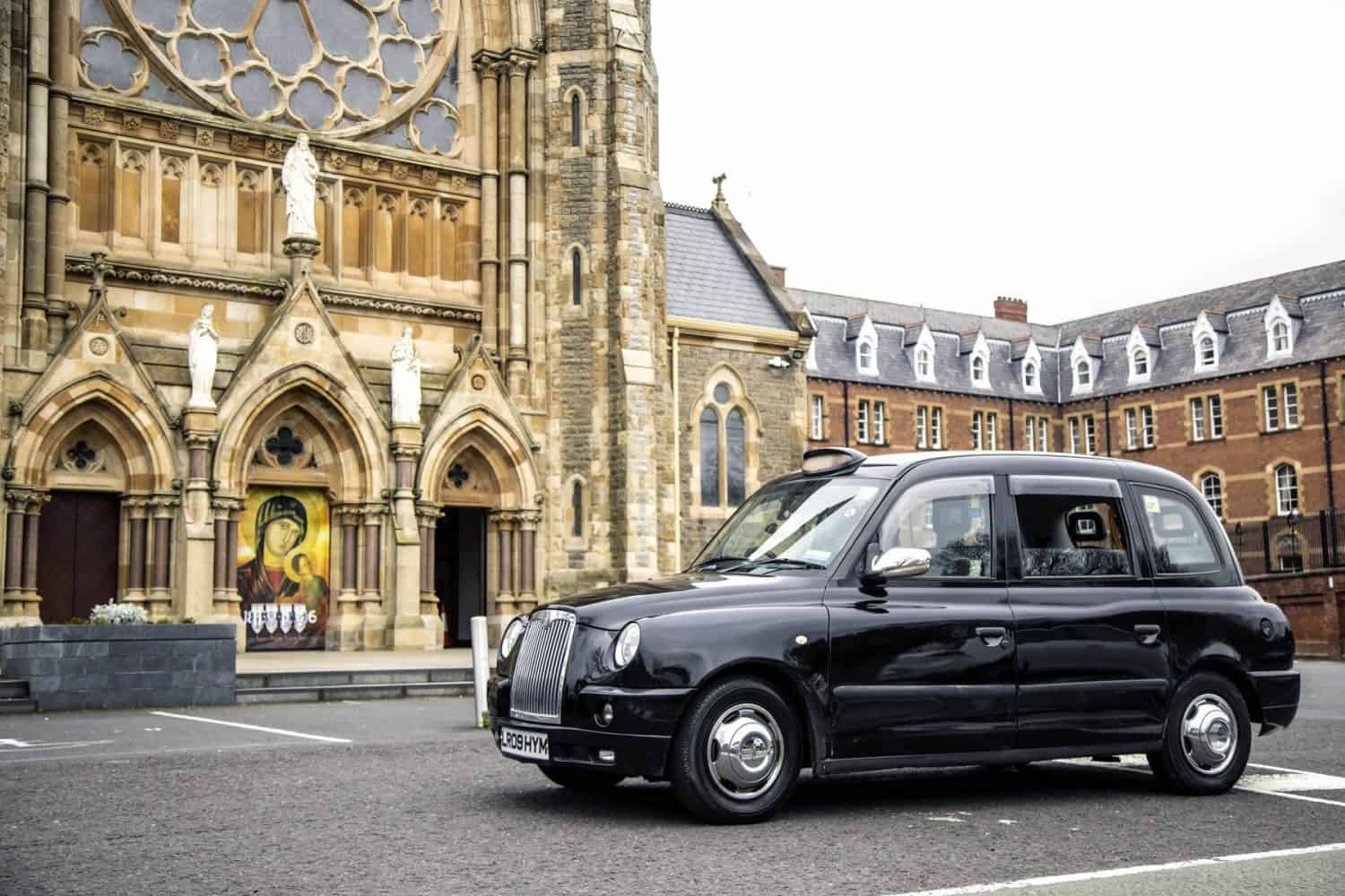 Black Taxi Tour Belfast Parked at Clonard Monastery