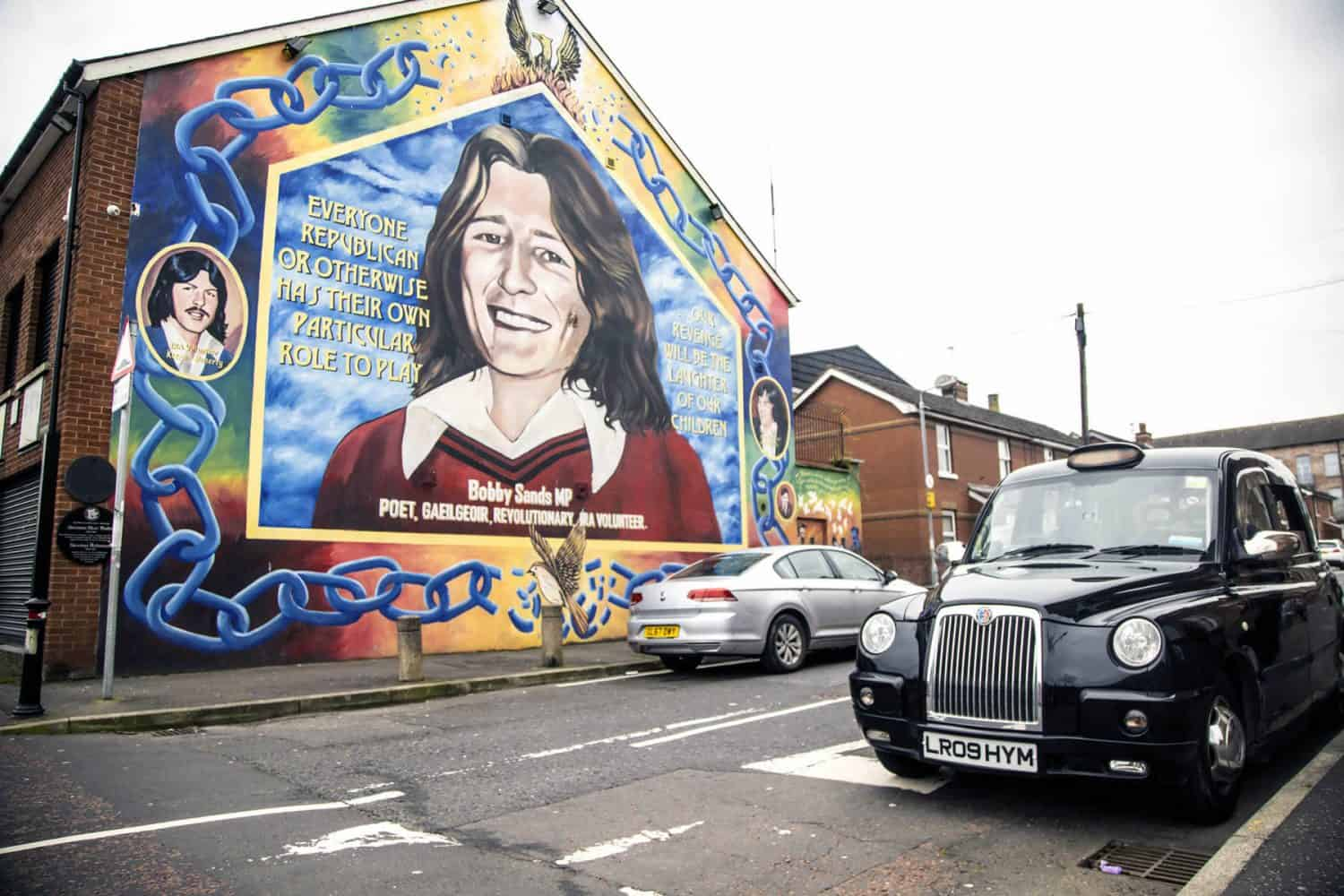 Bobby Sands Mural in Falls Road Belfast with Black Cab Tours Taxi
