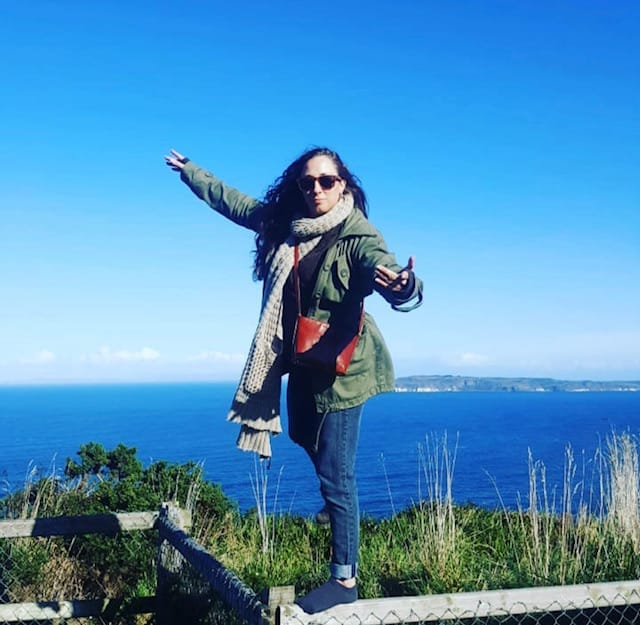 girl posing for photo on giants causeway tour from Belfast